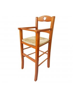 Vista diagonale di un seggiolone bimbo in legno artigianale colore ciliegio Totò Piccinni