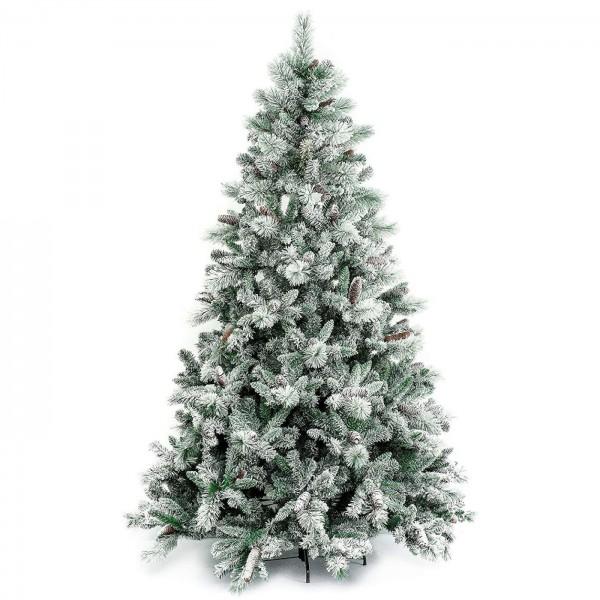 Foto di un albero di natale realistico innevato verde e bianco con pigne gardena xone
