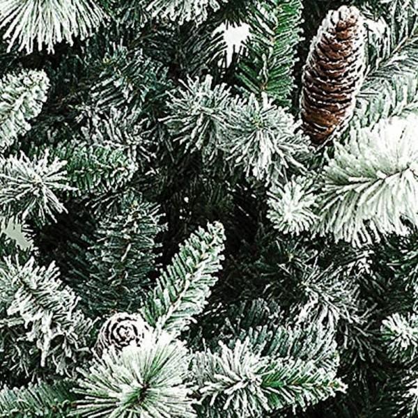 Rami e pigne di un albero di natale realistico verde con neve artificiale bianca gardena xone