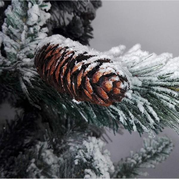 Pigna realistica e rametti imbiancati da neve artificiale di un albero di natale gardena xone